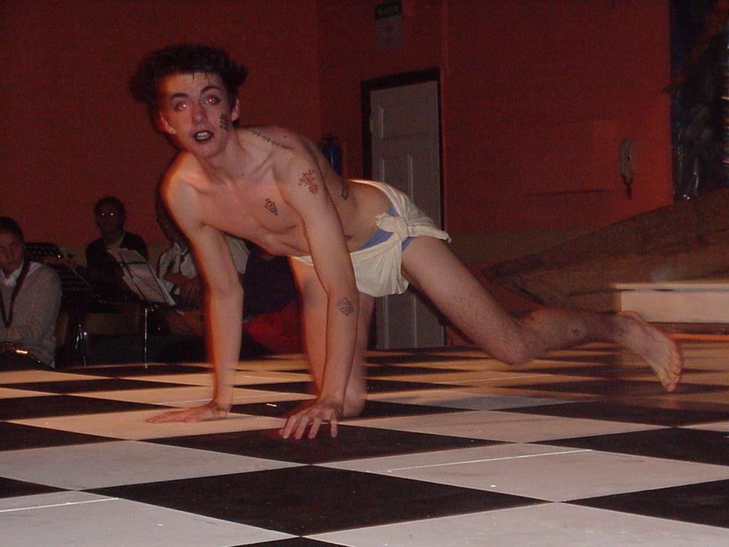 Simon Watson as an earthy and athletic Caliban